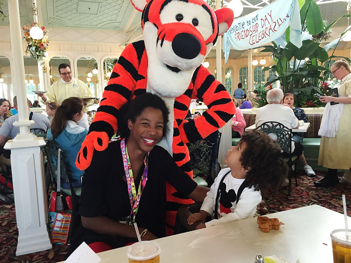 Toddler enjoying Tigger at Disney World. 13 tips to planning a Disney World vacation without all the stress! love these tips. #5 is great!