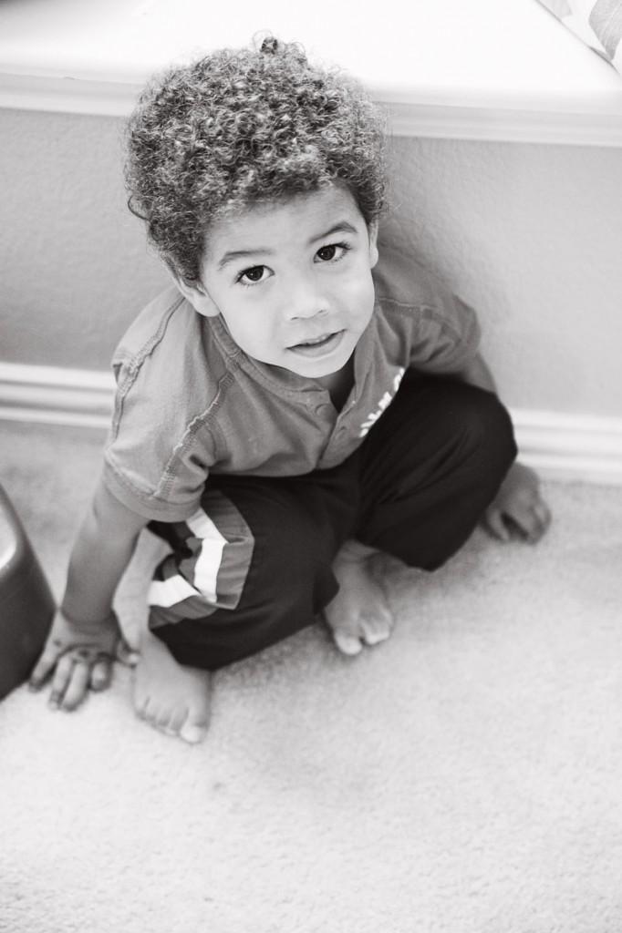 Surviving your child's first hair cut. Biracial boy interracial family