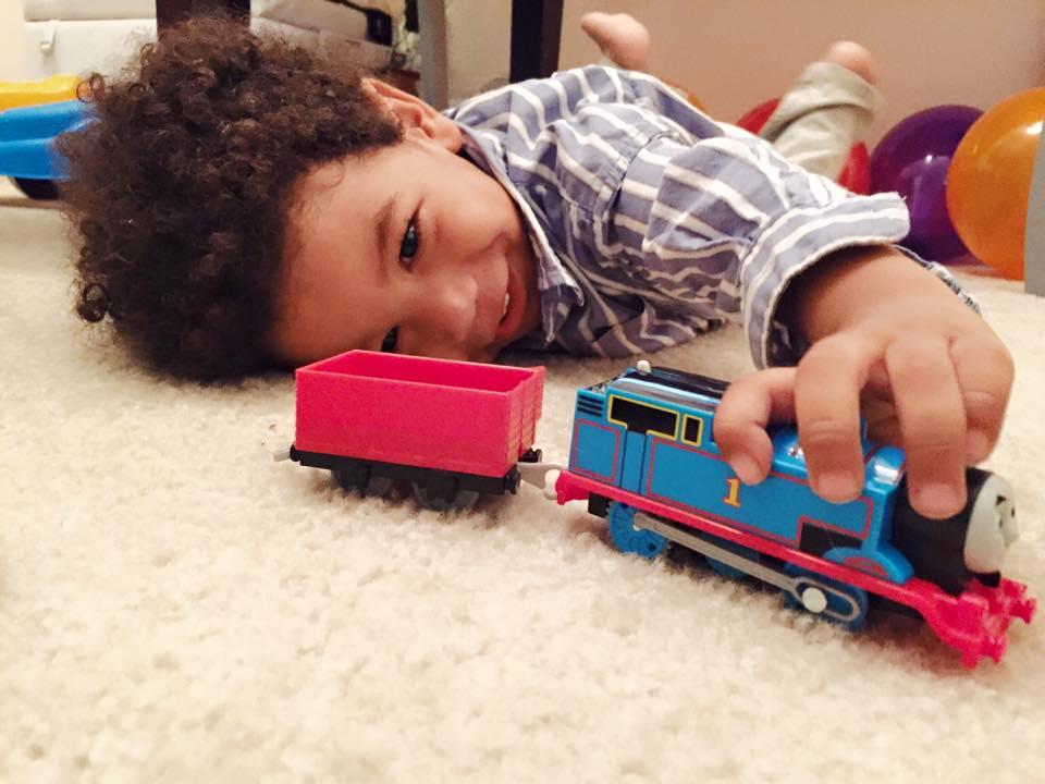 biracial boy trains