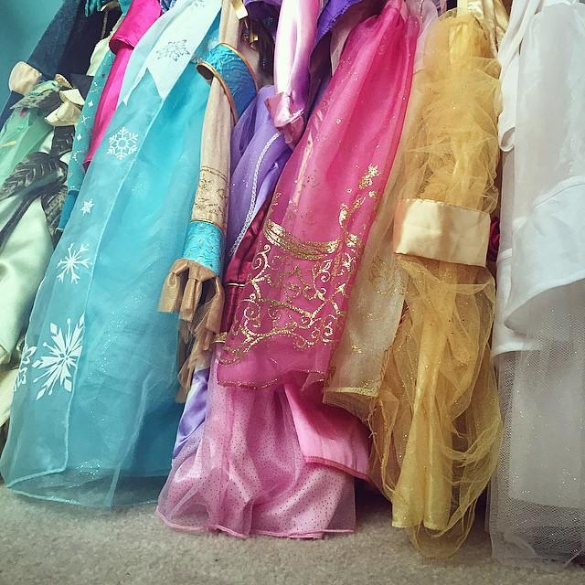 22 princess dresses on a lower closer rack