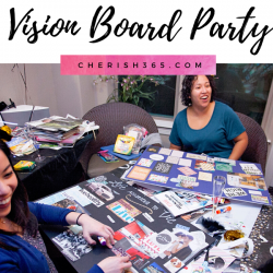 A table covered in magazines at a vision board party with two women at the table
