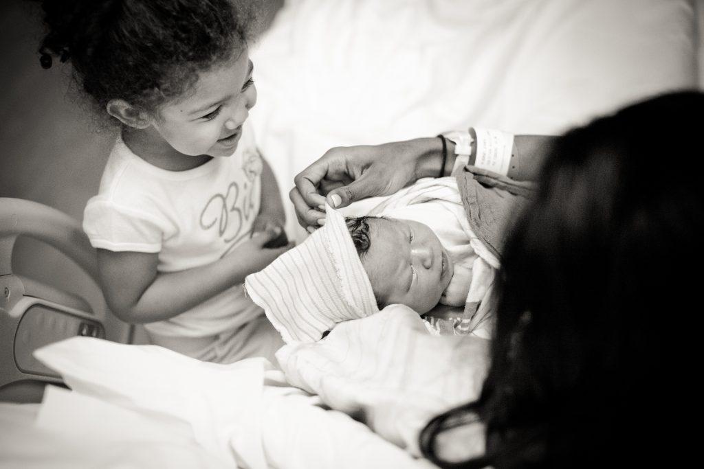 Siblings meeting in hospital