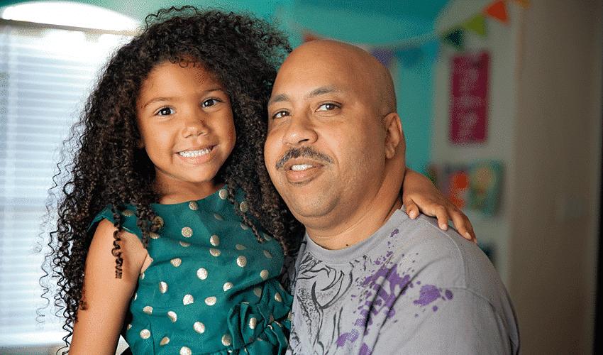 Biracial girl and creole grandpa