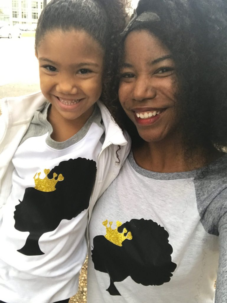 black mom with her biracial daughter wearing Black Queen shirts