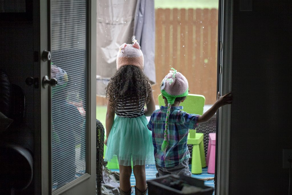 kids watching the rain