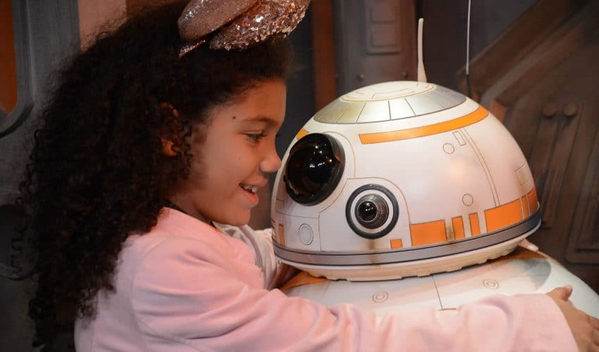 Little biracial girl meets BB-8 on the Star Wars Guided Tour at Disney's Hollywood Studios
