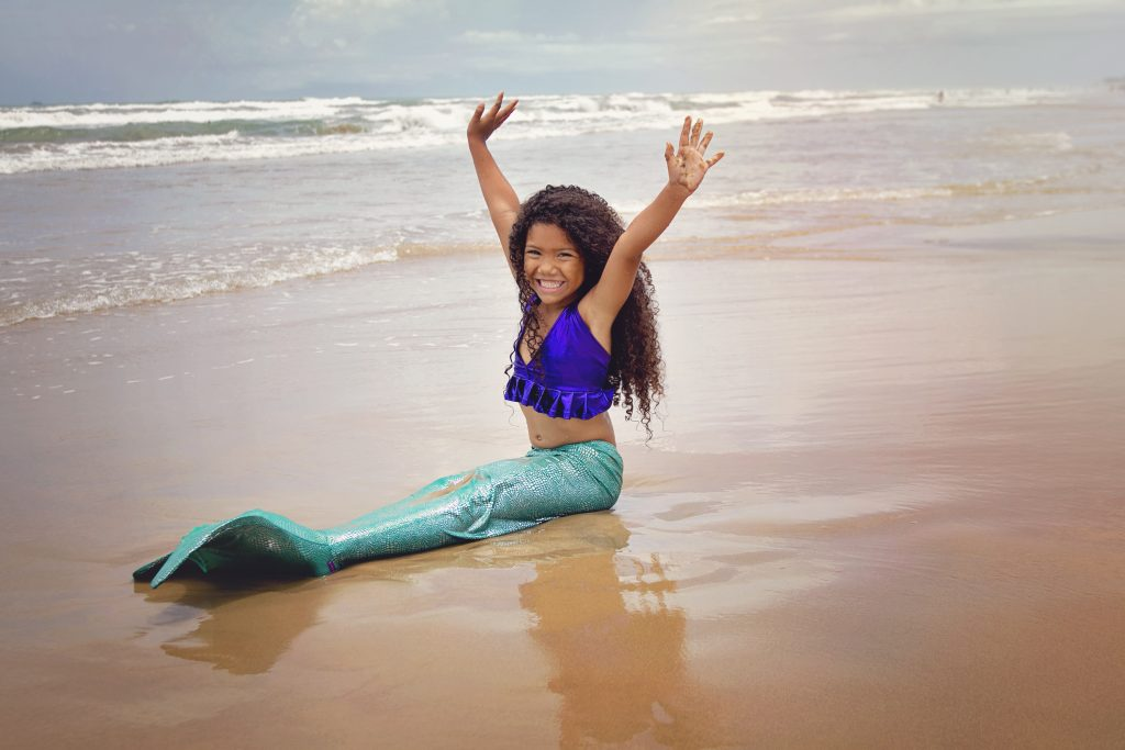 Little biracial girl dressed up as a Disney princess Black Ariel