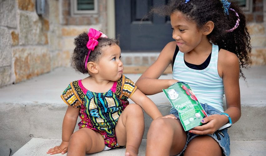two sisters sharing a gerber snack for terracycle