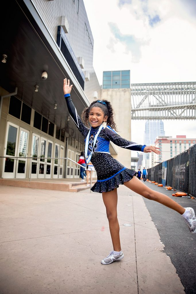 Biracial cheerleader about to strike a pose before her all-star-cheer competition.