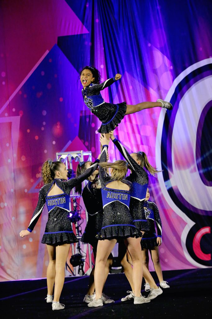 All star Competitive cheerleader stunt taken by a cheer mom