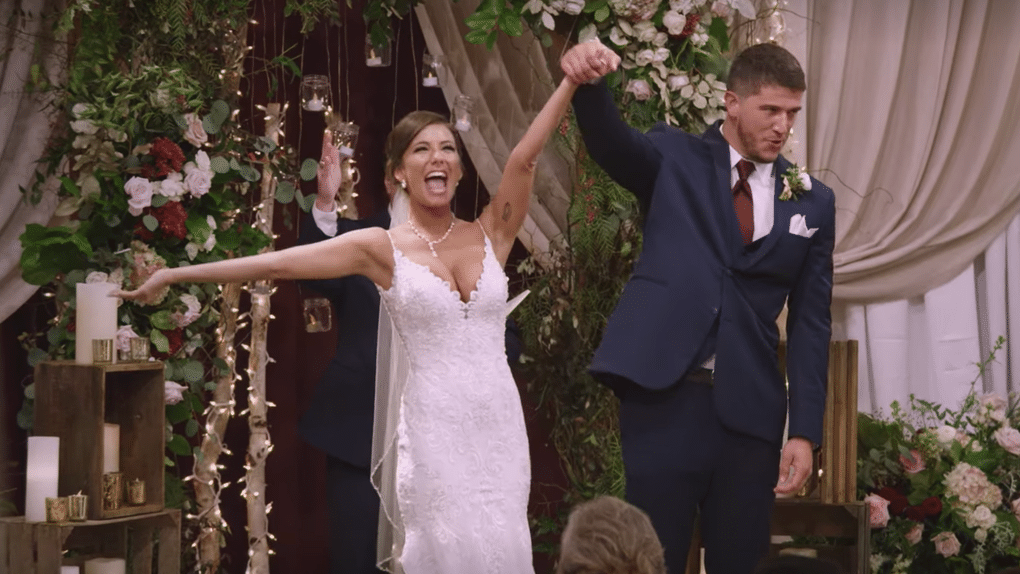 Ashley and Barnett from Netflix Love is Blind celebrate their wedding.