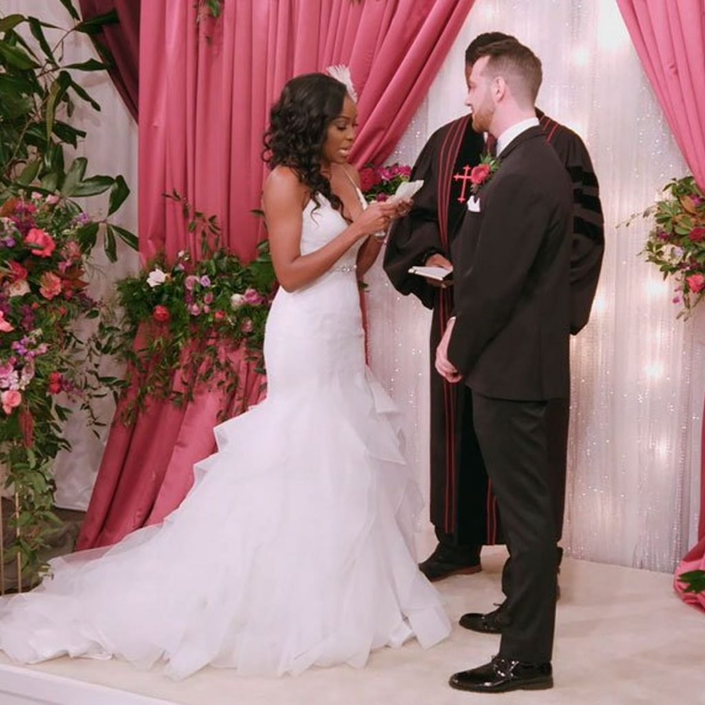 Black bride and white groom on Netflix's Love is Blind at the wedding alter