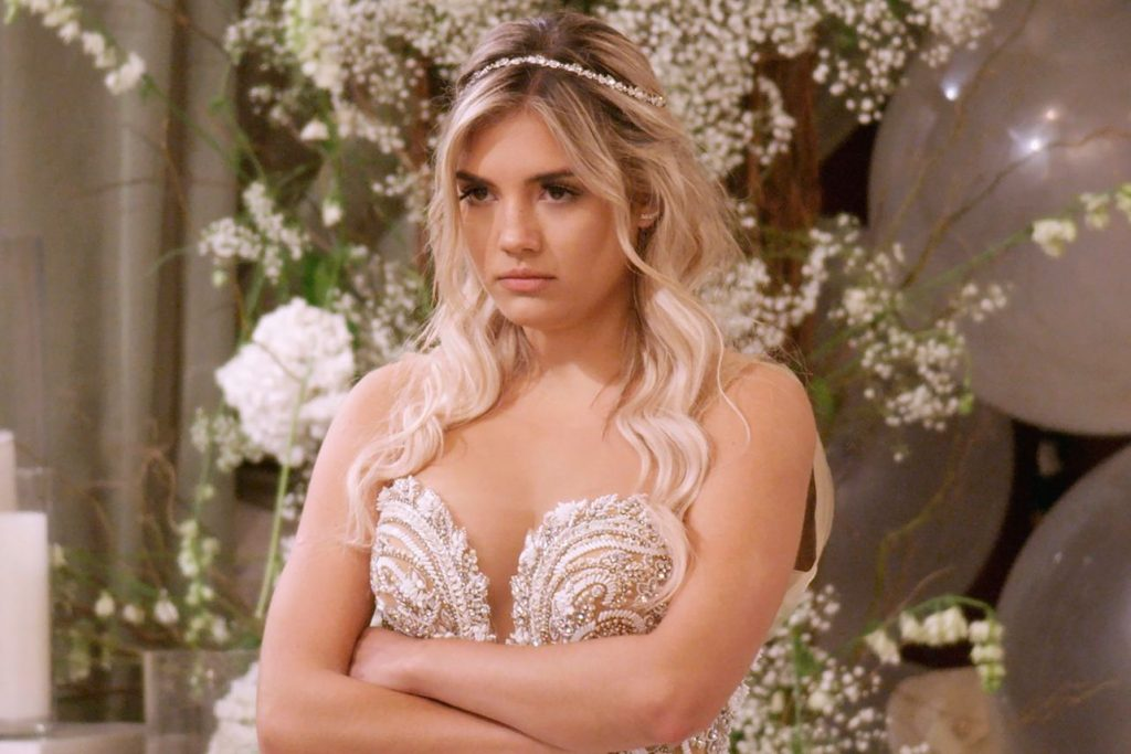 Blond bride Giannina from Netflix's Love is bling stands angry at the wedding alter