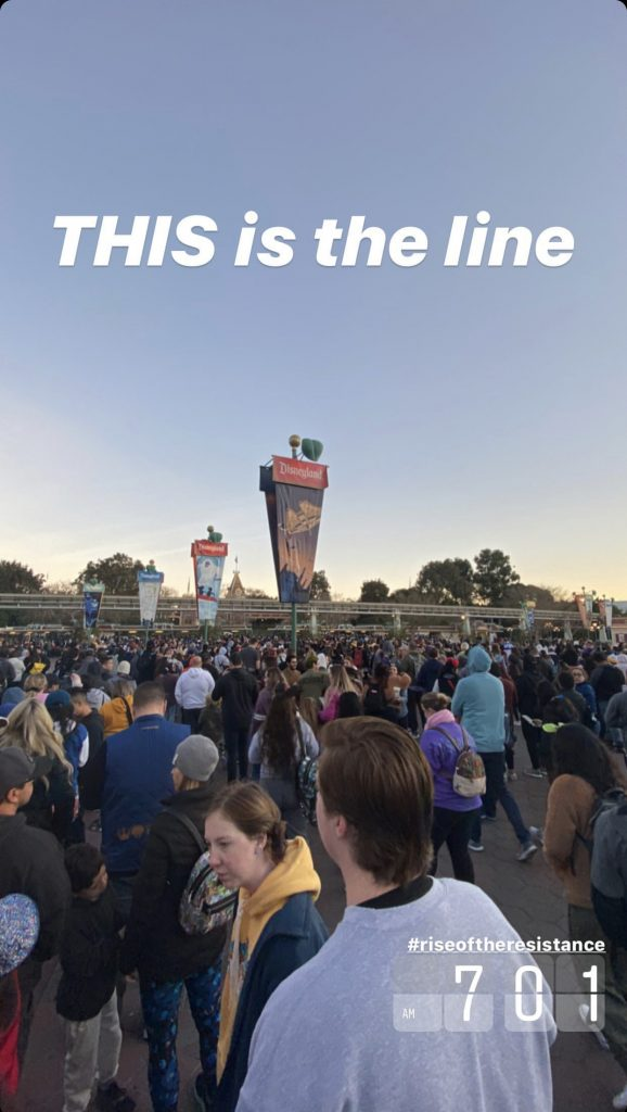 The wait line to get into security at Disneyland before the opening of the park.