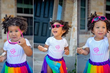 Biracial toddler wearing her DIY cricut shirt