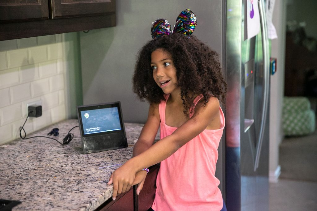 Biriaicla girl in disney mickey ears playing a disney trivia game on Alexa