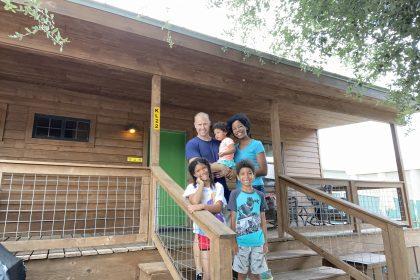 interracial family at a camping cabin koa kampground