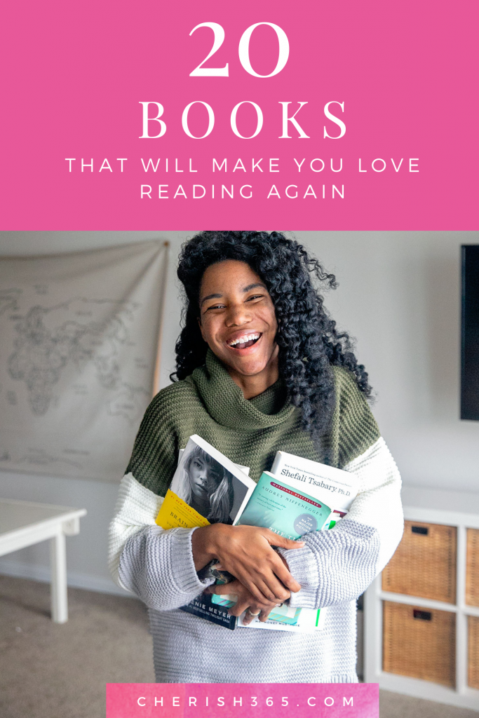 black woman holding a handfull of great books that will make you love reading again