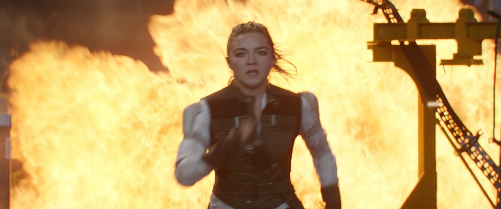 Girl running from explosion in Marvel's new Black Widow movie.