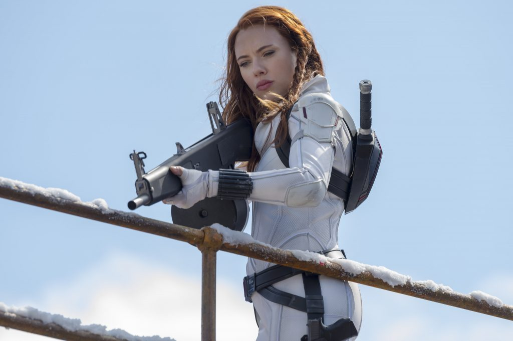 Black Widow is holding a rifle and aiming at her target.