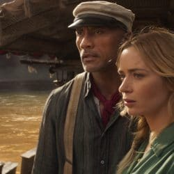 Emily Blunt and Dwane Johnson standing on a boat for Disney's Jungle Cruise